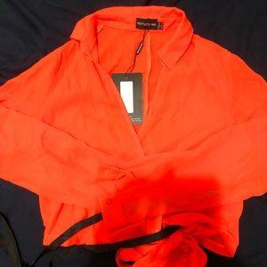 PLT orange wrap top